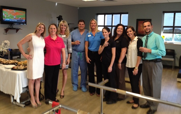 Dr. Datta enjoying some refreshments and good conversation at the Open House sponsored by CORA Physical Therapy