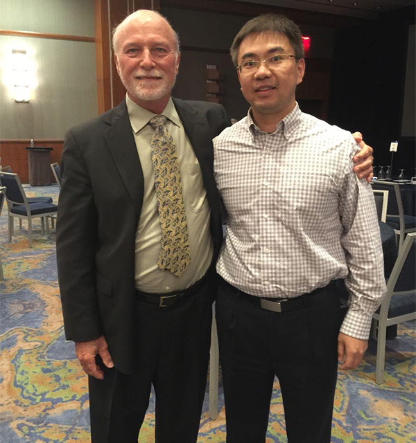 Dr. Ming Yang from Xi'an Honghui Hospital of China and Dr. Hynes at